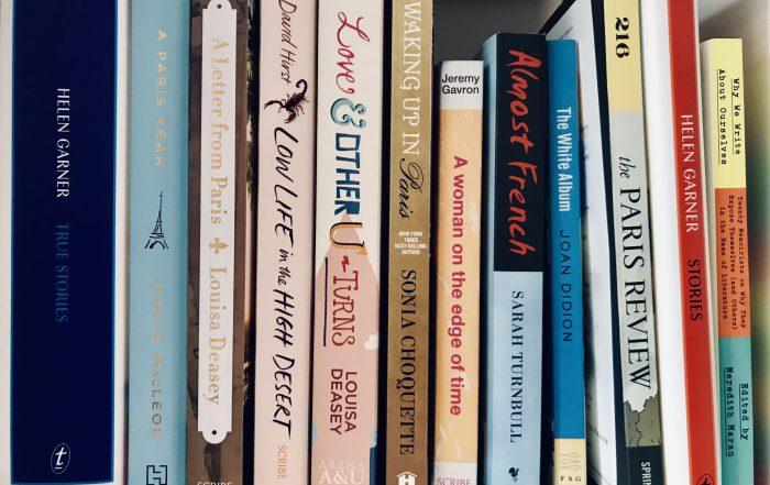paperback memoir spines on a shelf
