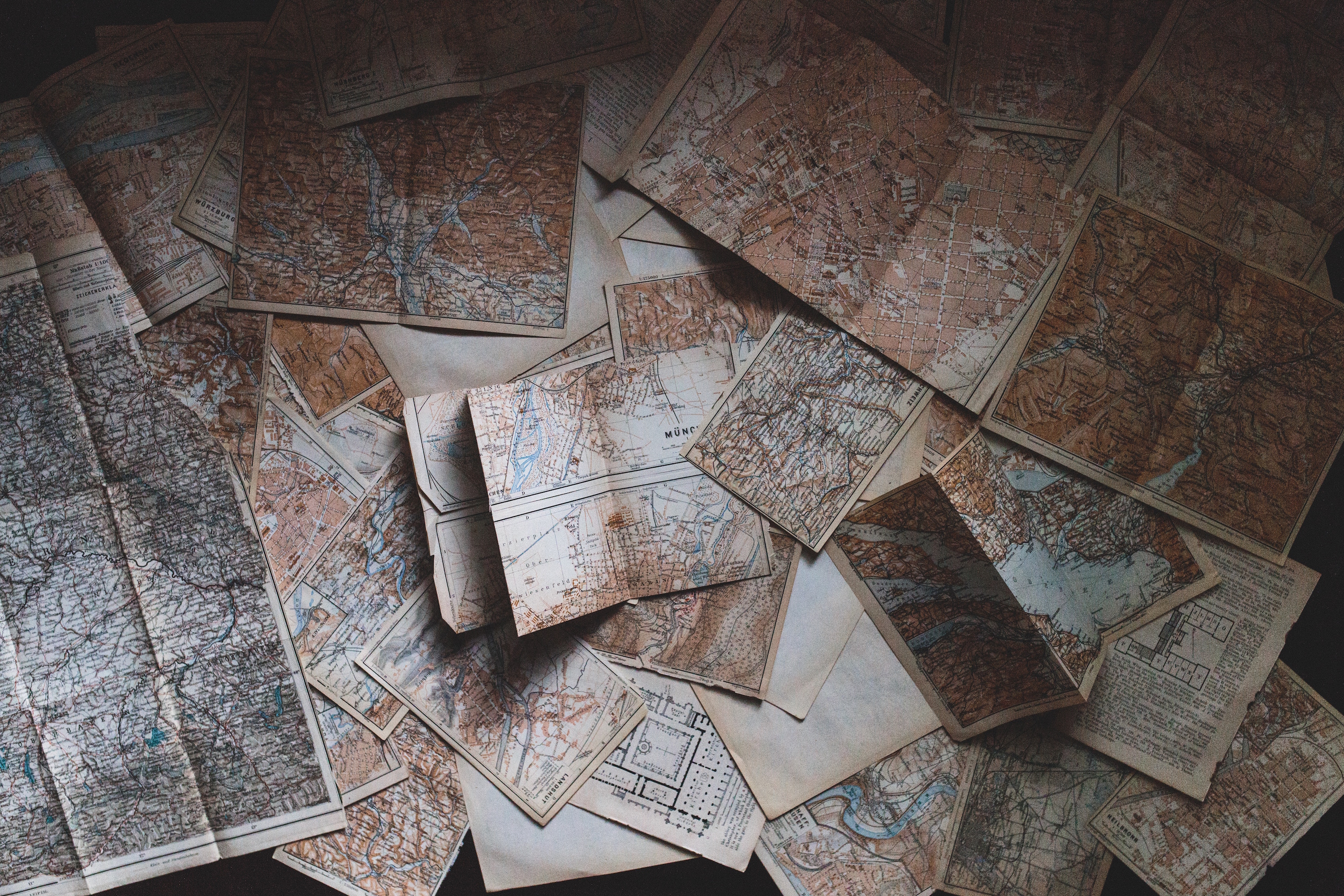 paper maps on a floor
